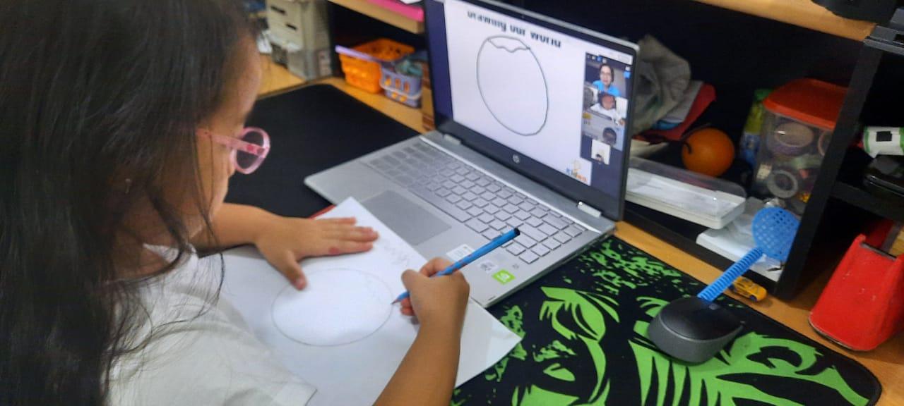 child doing online lesson